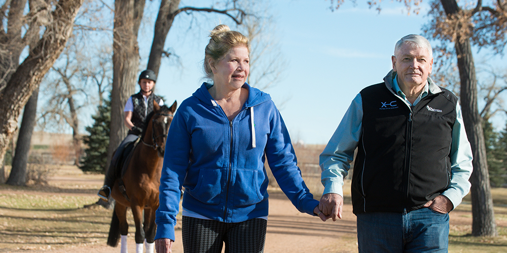 Leslie and John Malone walk at Harmony Sporthorses, December 2, 2014.